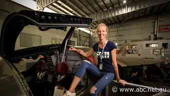 Aviation fanatic looks after the last F-111 to switch off its engines