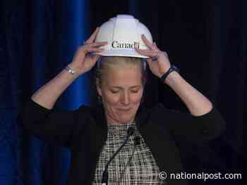 McKenna dons hard hat, vows to pick up pace of infrastructure projects