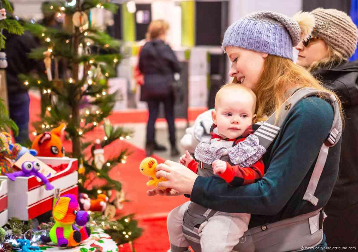 Photos: Farmers' Market hosts Christmas show sale