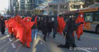 Vancouver police arrest 5 climate change protesters staging 'funeral procession'