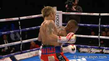 Casimero beats Zolani for world 118 lbs. title
