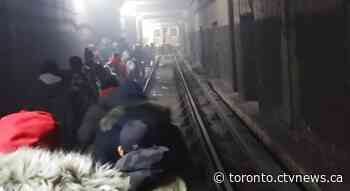 Commuters forced to walk through subway tunnel after fire suspends TTC service