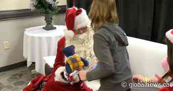 Santa Claus makes early stop for children with special needs in Regina