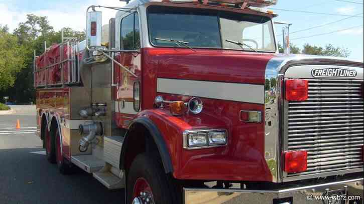 Parked truck catches fire, flames spread to home