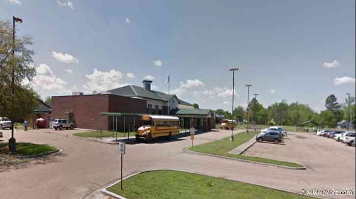 Louisiana police: Man shot into school, hid inside for hours