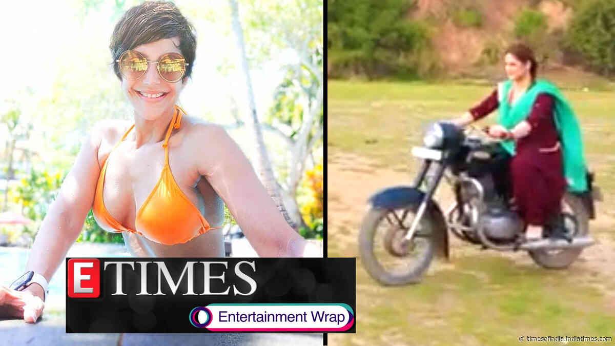 Mandira Bedi flaunts incredibly toned figure in orange bikini; Zareen Khan rides motorcycle like a pro, and more…