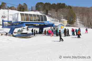Two local ski hills to team up