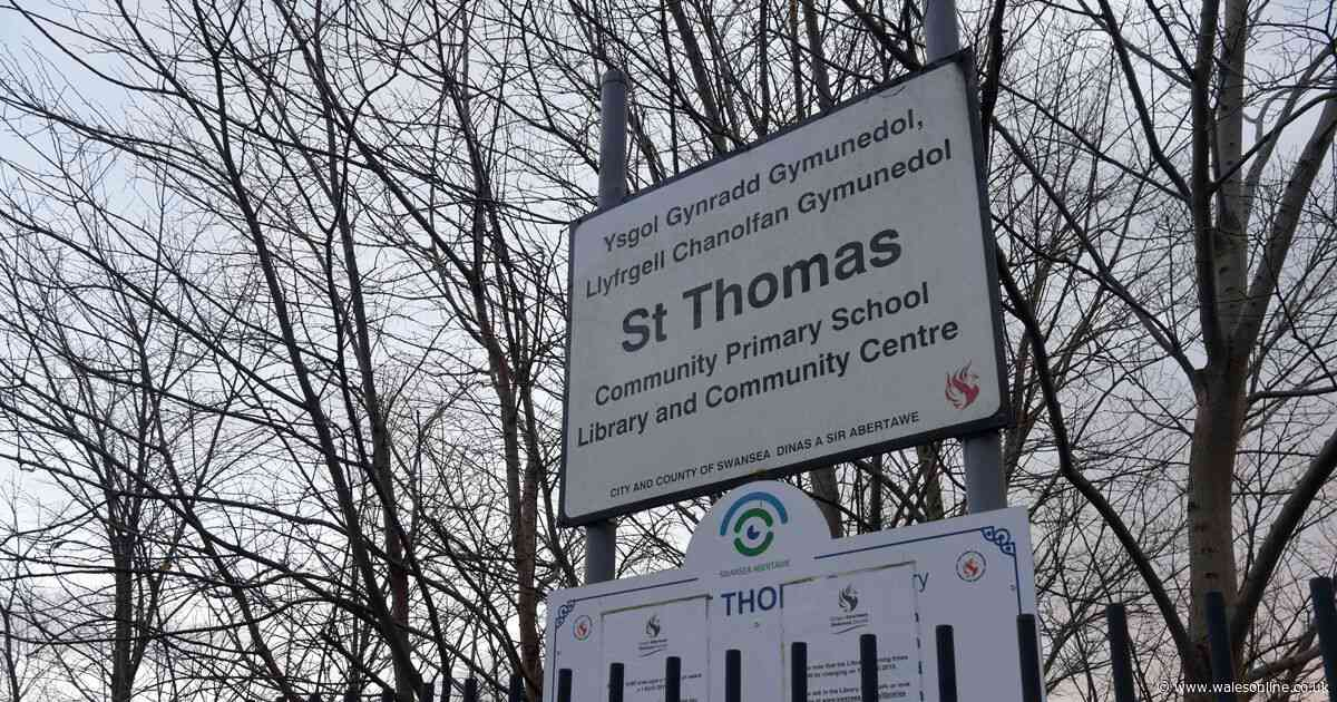 A member of teaching staff has died while at a Swansea primary school
