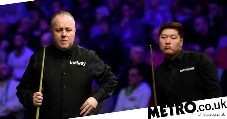 John Higgins reacts after joining Ronnie O'Sullivan in exiting UK Championship
