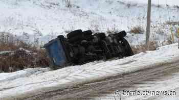 Two dump trucks slide into ditch one after another