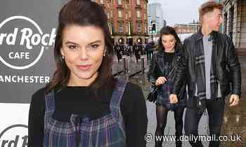 Faye Brookes holds hands with Joe Davies as the pair attend a charity Christmas quiz in Manchester