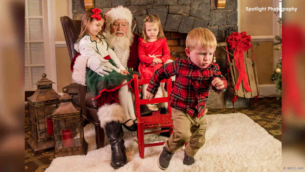 2-year-old quickly decides against sitting with his sisters for picture with Santa