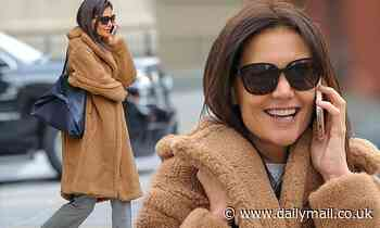 Katie Holmes bundles up warm in a faux fur coat and checked trousers during chilly NYC outing