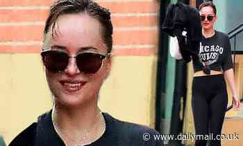 Dakota Johnson flashes her toned figure and a big smile after her morning sweat session