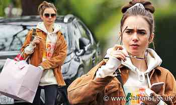 Lily Collins cuts a casual figure in oversize hoodie and jacket