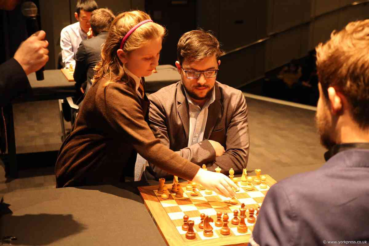 Budding York player meets world chess champion - and makes first move