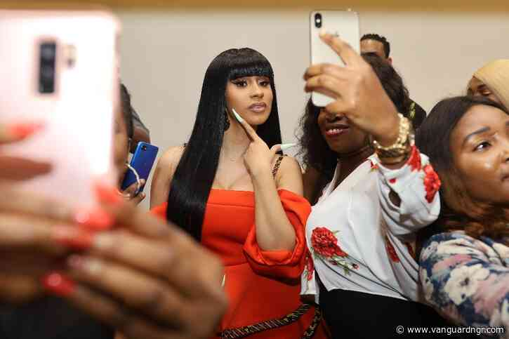 Cardi B joins Lagos nightlife, visits strip club with Jidenna