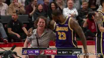 LeBron bumps into court side attendant