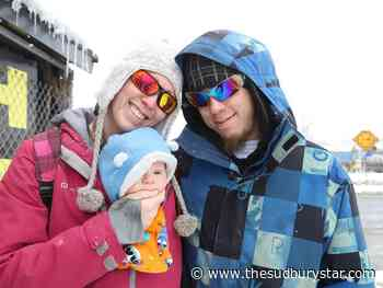 Mom, dad and baby snuggle to keep Sudbury's cold weather at bay