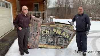 Treasure hunter finds Chipman's first neon sign buried in snow in woods