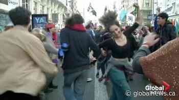 Climate protesters hold dance party in central Madrid