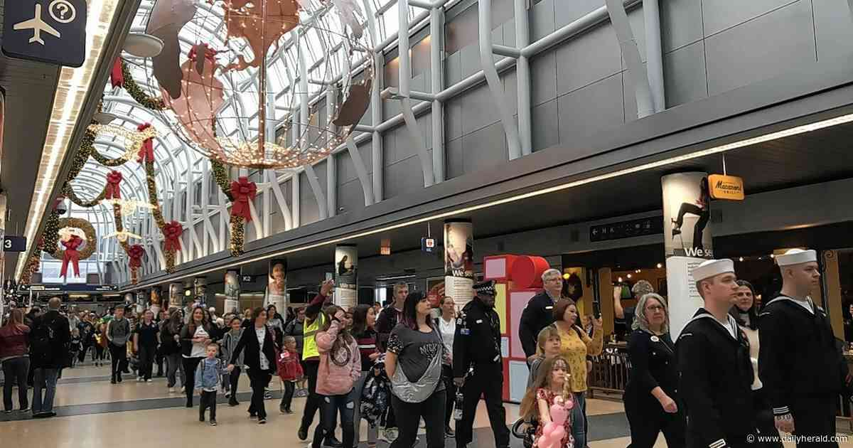 Gold Star families get festive sendoff  at O'Hare before Disney World trip