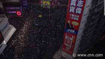 Hong Kong protesters keep up pressure with mass march