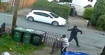 Chilling images show boy cower in fear as thugs fire crossbow at house