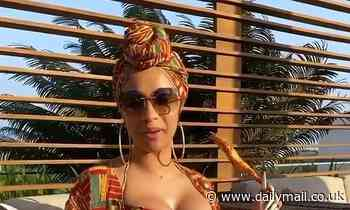 Cardi B puts on busty display on her Ghana hotel rooftop as she enjoys first ever trip to Africa