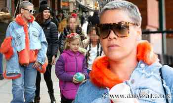 Pink bundles up in a denim jacket with vibrant orange fur as she steps out with daughter Willow