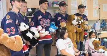 Pats players shower kids at Regina General Hospital with teddy bears