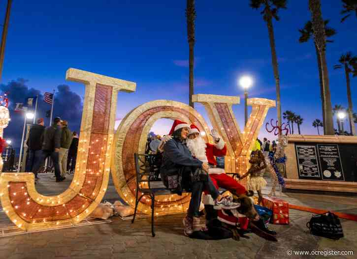 Giant snowflakes come aglow for the holidays at Huntington Beach Pier
