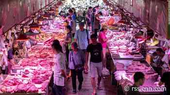 Asian markets mixed after soaring pork prices push China's inflation rate to eight-year high