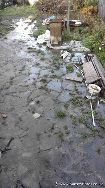 Harrow garden overflowing with sewage and waste