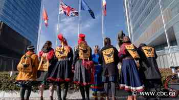 First Nations youth protest proposed massive oilsands mine at UN climate conference