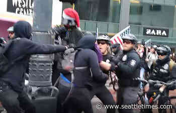Seattle police open preliminary investigation into viral video of clash between officers and anti-Trump protesters