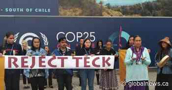 Indigenous activists protest proposal of massive oilsands mine at COP25 in Madrid