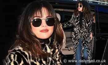 Selena Gomez debuts a wispy fringe and sports a fur coat with flares as she channels the Seventies