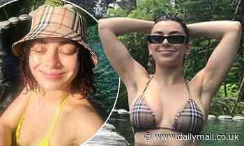 Charli XCX puts on a busty display in a tiny Burberry bikini