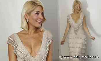 Holly Willoughby dazzles in a plunging fringed gown in snap from Dancing On Ice Christmas special