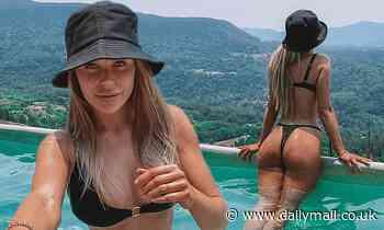 Former Big Brother star Skye Wheatley flashes the flesh in a skimpy black bikini