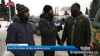 Edmonton Eskimos drop by Global Give Me Shelter donation drive