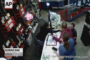 Big save: Pawn shop manager snares baby falling off counter