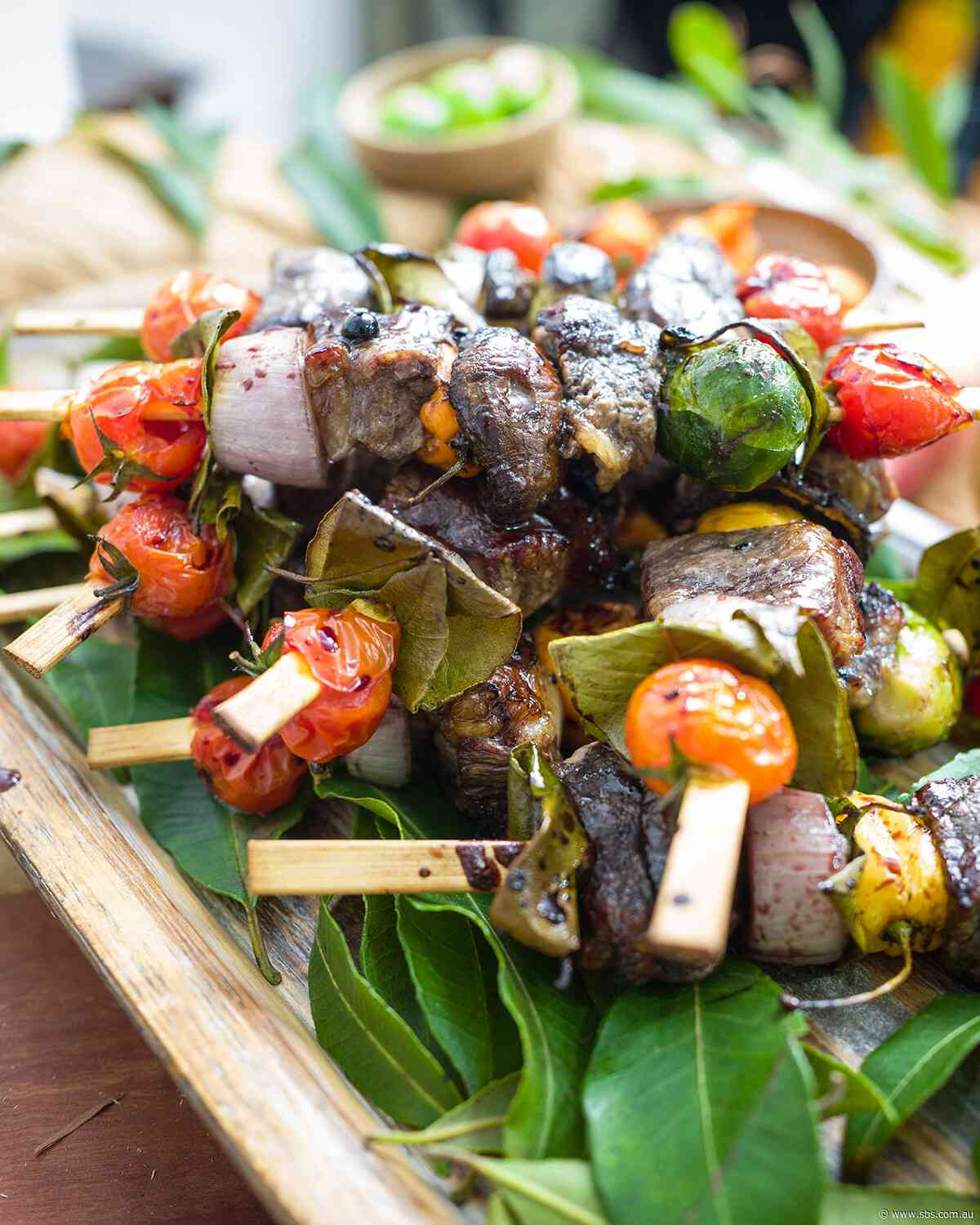 Grilled beef skewers with pepperberry sauce