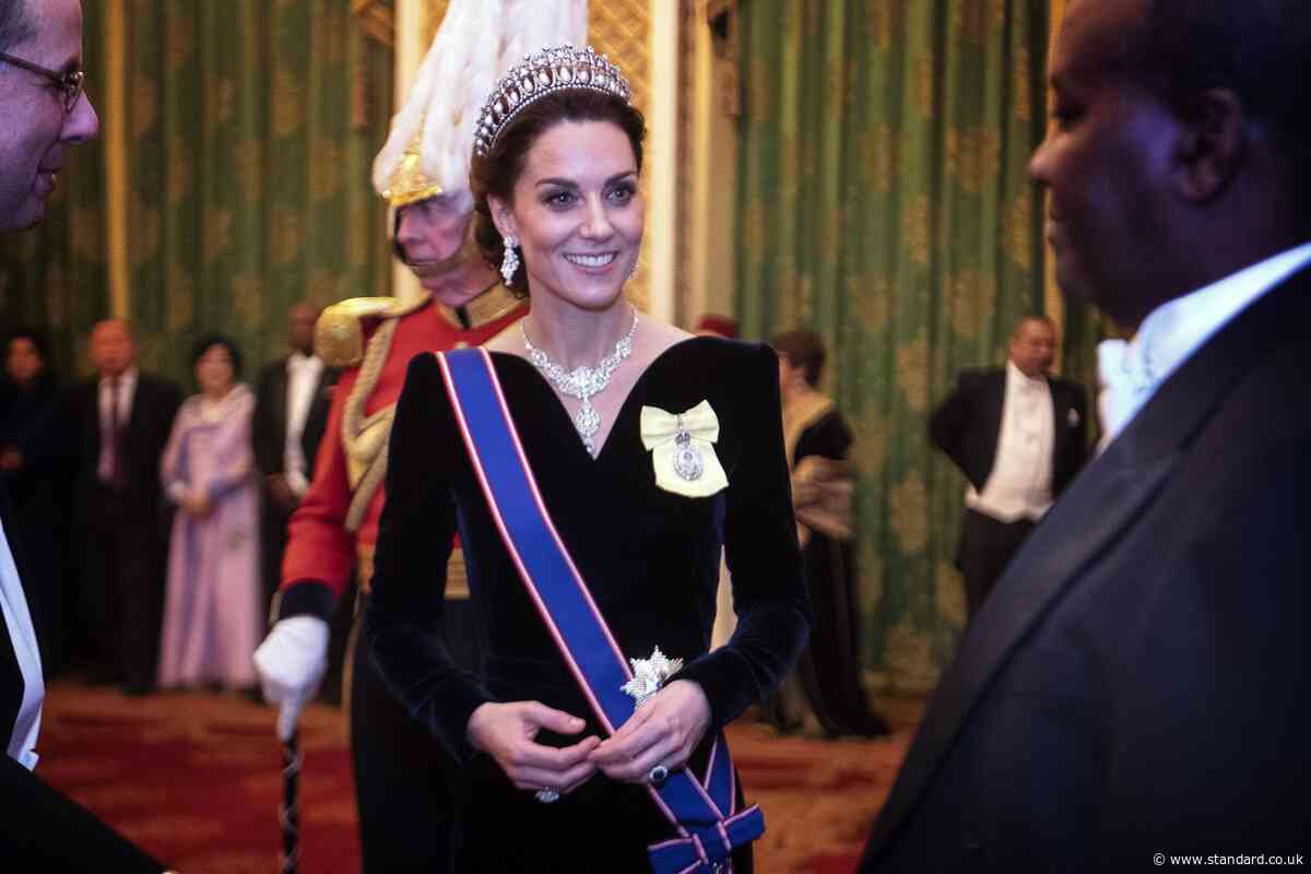 Kate Middleton dazzles in Alexander McQueen and Princess Diana's tiara for a reception at Buckingham Palace