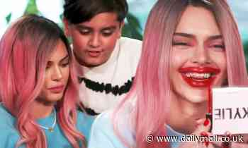 Kendall Jenner mocks Kylie's inflated lips as she smears gloss over her face