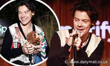 Harry Styles wears a pearl necklace and sports red and black nail varnish at LA event