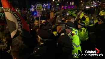 Protesters against re-elected British PM Boris Johnson clash with police