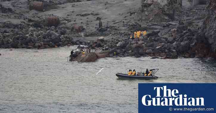 White Island volcano eruption: police divers search sea for missing bodies