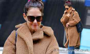 Katie Holmes fends of the winter chill as she picks up some large pieces of art in NYC